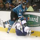 Edmonton Oilers center Leon Draisaitl (29) is checked into the boards by San Jose Sharks defenseman Justin Braun (61) during the second period of an NHL hockey game Tuesday, Dec. 9, 2014, in San Jose, Calif The Associated Press