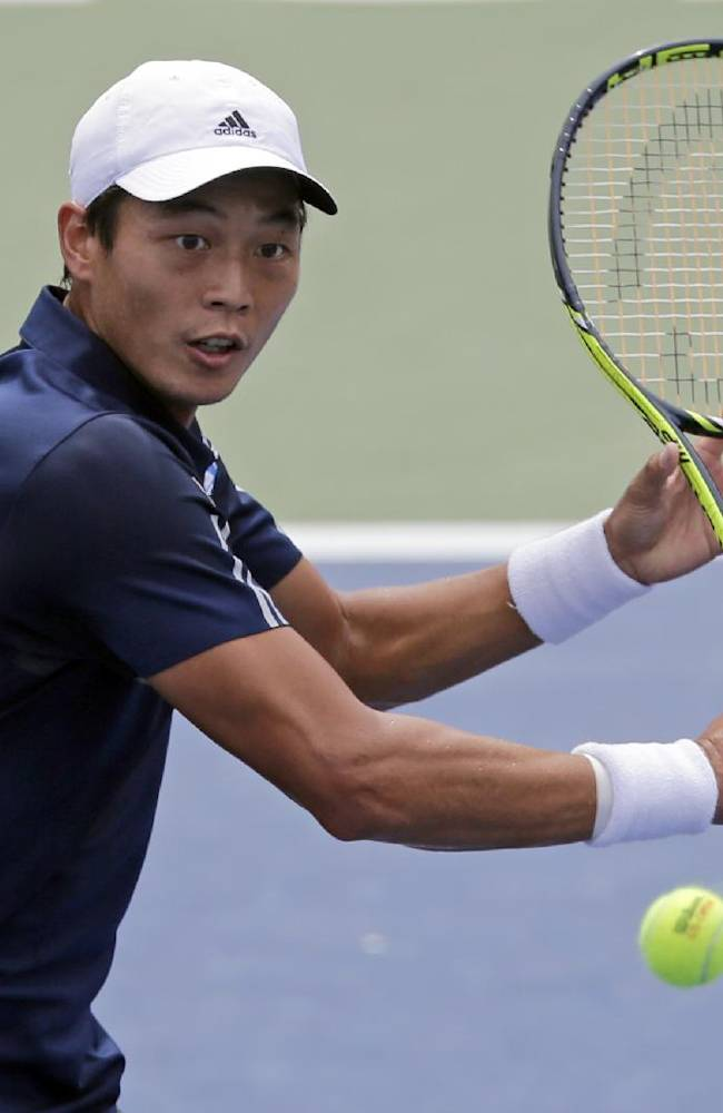Yen-Hsun Lu, of Taiwan, returns a shot against Andreas Seppi, of Italy, during their match at the Winston-Salem Open tennis tournament in Winston-Salem, N.C., Thursday, Aug. 21, 2014