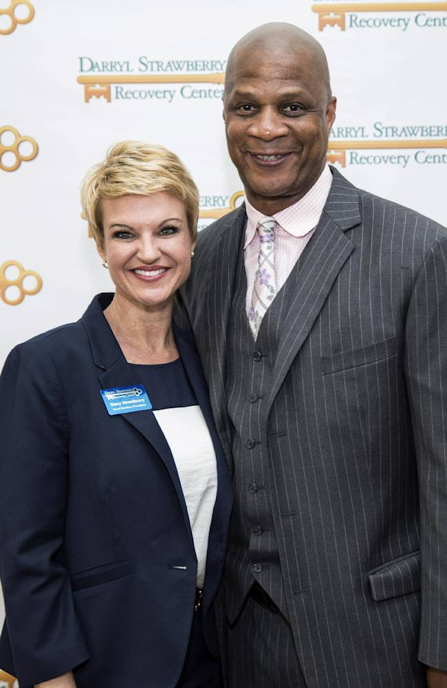 Tracy Strawberry, left, and her husband, former baseball player Darryl Strawberry, pose at an event for the Darryl Strawberry Recovery Center in St. Cloud, Fla., Friday, Jan. 24, 2014. The center features a program aimed at helping athletes address post-playing issues