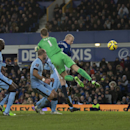 Everton's Steven Naismith, centre right, scores past Manchester City's goalkeeper Joe Hart during the English Premier League soccer match between Everton and Manchester City at Goodison Park Stadium, Liverpool, England, Saturday Jan. 10, 2015