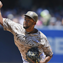 San Diego Padres starting pitcher Odrisamer Despaigne throws against the New York Mets in the first inning of a baseball game Sunday, July 20, 2014, in San Diego. (AP Photo/Lenny Ignelzi)