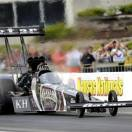 In this photo provided by NHRA, Shawn Langdon drives his Top Fuel dragster to the No. 1 qualifying position Saturday, May 18, 2013, at Heartland Park Topeka for the NHRA Kansas Nationals drag races in Topeka, Kan. He topped the field with a performance of  3.767 seconds at 322.50 mph. (AP Photo/NHRA, Marc Gewertz)