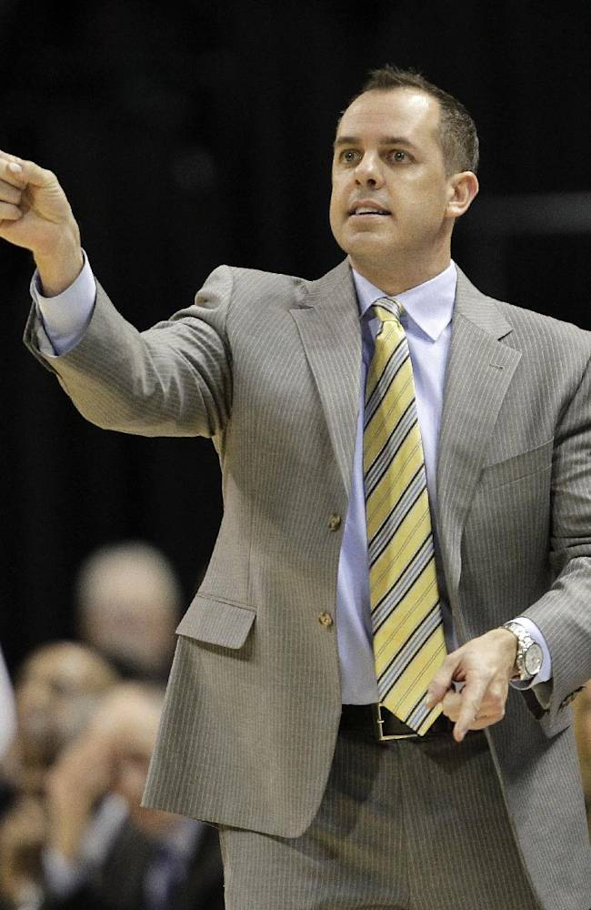 Indiana Pacers head coach Frank Vogel calls in a play during the second half of an NBA basketball game against the Charlotte Bobcats in Indianapolis, Friday, Dec. 13, 2013. The Pacers won 99-94