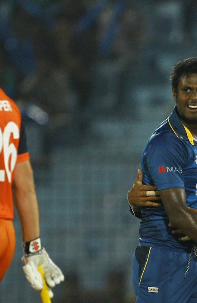 Sri Lanka's Ajantha Mendis, second right, celebrates with his teammate the wicket of Netherlands's Wesley Barresi during their ICC Twenty20 Cricket World Cup match in Chittagong, Bangladesh, Monday, March 24, 2014