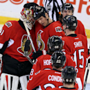 Ottawa Senators goaltender Craig Anderson (41) and teammates Marc Methot (3) Zack Smith (15) Mike Hoffman (68) Erik Condra (22) and Erik Karlsson (65) celebrate after defeating the Toronto Maple Leafs 1-0 in NHL hockey game action in Ottawa, Ontario, Satu
