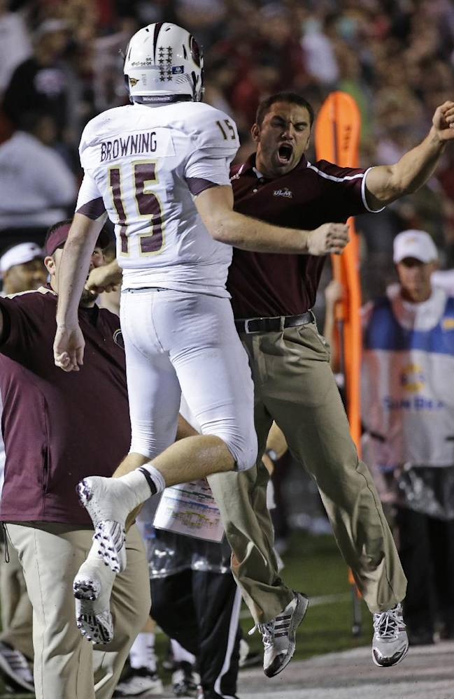 Louisiana-Monroe quarterback Kolton Browning (15) celebrates a score during the second half of an NCAA college football game against Troy in Troy, Ala., Thursday, Oct. 31, 2013. Louisiana-Monroe won 49-37