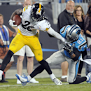 Pittsburgh Steelers' Le'Veon Bell (26) is tackled by Pittsburgh Steelers' Robert Golden (21) during the second half of an NFL football game in Charlotte, N.C., Sunday, Sept. 21, 2014. (AP Photo/Mike McCarn)
