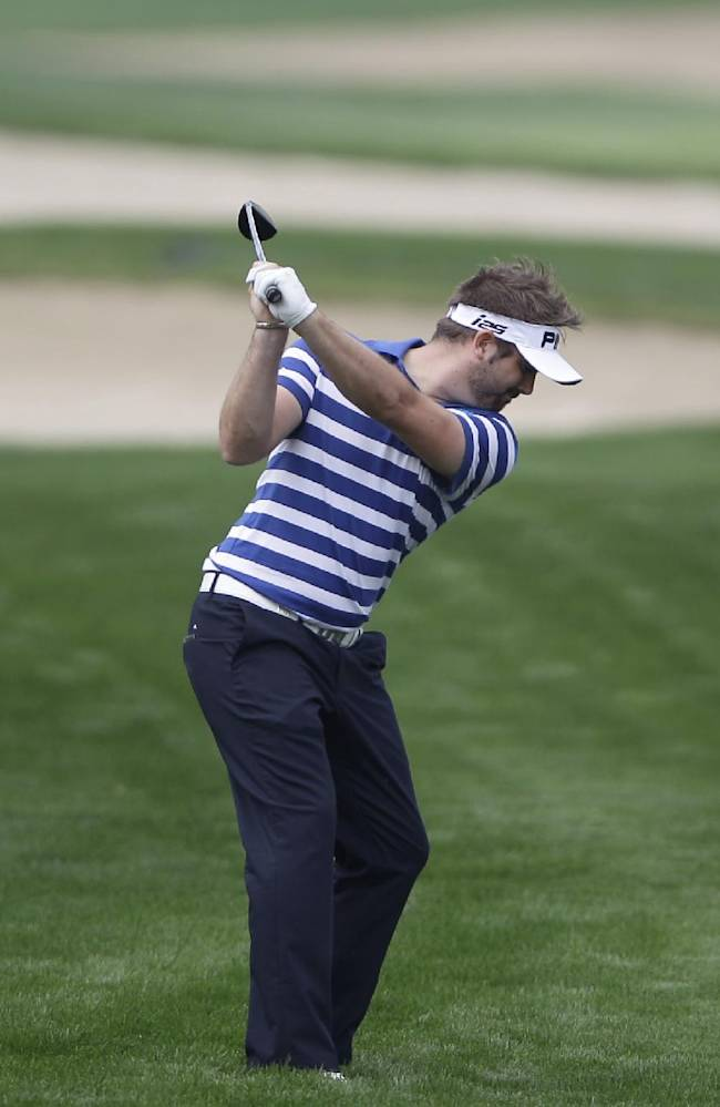 Matthew Baldwin of England plays a ball on the 8th hole during the 1st round of the Abu Dhabi HSBC Golf Championship in Abu Dhabi, United Arab Emirates, Thursday, Jan. 16, 2014