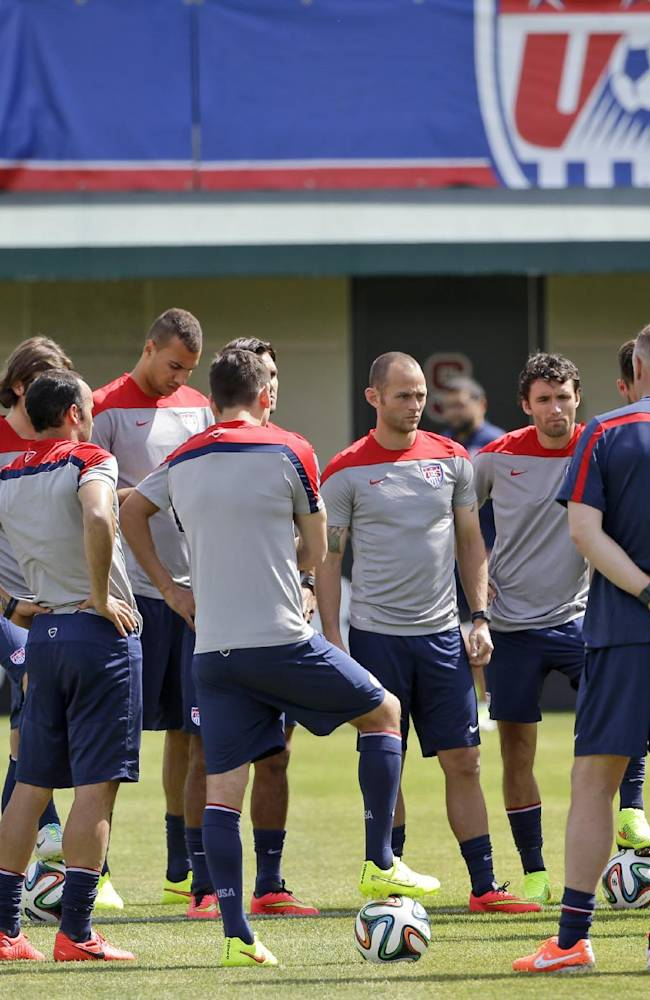 United States head coach Jurgen Klinsmann, at right, instructs his team during a training session in preparation for the World Cup soccer tournament on Friday, May 16, 2014, in Stanford, Calif