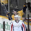 Nashville Predators forward Patric Hornqvist (27), of Sweden, celebrates behind Washington Capitals defenseman Karl Alzner (27) after scoring a goal in the first period of an NHL hockey game on Sunday, March 30, 2014, in Nashville, Tenn The Associated Pre