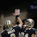 New Orleans Saints wide receiver Kenny Stills (84) celebrates his touchdown reception with quarterback Drew Brees (9) in the second half of an NFL football game in New Orleans, Sunday, Nov. 16, 2014 The Associated Press