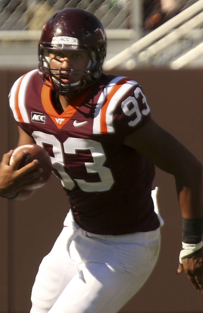 In this Saturday, Sept. 7, 2013, photo, Virginia Tech wide receiver Kalvin Cline runs with the ball during an NCAA college football game against Western Carolina in Blacksburg  Va. The freshman tight end from Boca Raton, Fla., didn't play football until his senior year of high school. Now, injuries have him pressed into duty for the Hokies, and he's learning on the job. Cline caught four passes for 46 yards last week in his college debut against Western Carolina