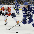 Tampa Bay Lightning center Steven Stamkos (91) gets ahead of Florida Panthers defenseman Brian Campbell (51) during the second period of an NHL preseason hockey game Saturday, Oct. 4, 2014, in Tampa, Fla The Associated Press
