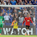 Manchester United players David De Gea, left, and Wayne Rooney react after Leicester's Jamie Vardy scored against Manchester United during the English Premier League soccer match between Leicester City and Manchester United at King Power Stadium, in Leic