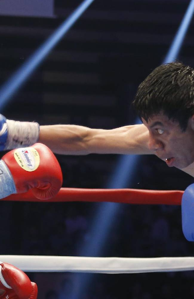 Odilon Zaleta of Mexico, right, hits a right to Akira Yaegashi of Japan during their WBC flyweight title bout in Tokyo, Sunday, April 6, 2014