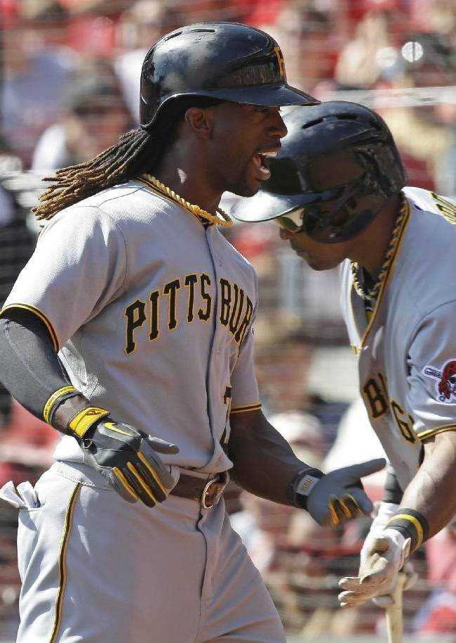 Pittsburgh Pirates' Andrew McCutchen, left, is congratulated by Marlon Byrd after McCutchen hit a solo home run off Cincinnati Reds starting pitcher Bronson Arroyo in the third inning of a baseball game, Saturday, Sept. 28, 2013, in Cincinnati