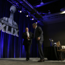 Seattle Seahawks head coach Pete Carroll, right, and New England Patriots head coach Bill Belichick shake hands after a news conference for NFL Super Bowl XLIX football game Friday, Jan. 30, 2015, in Phoenix The Associated Press