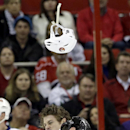 New York Islanders' Matt Martin loses his helmet while fighting with Carolina Hurricanes' Brett Bellemore during the second period of an NHL hockey game in Raleigh, N.C., Thursday, Nov. 7, 2013 The Associated Press