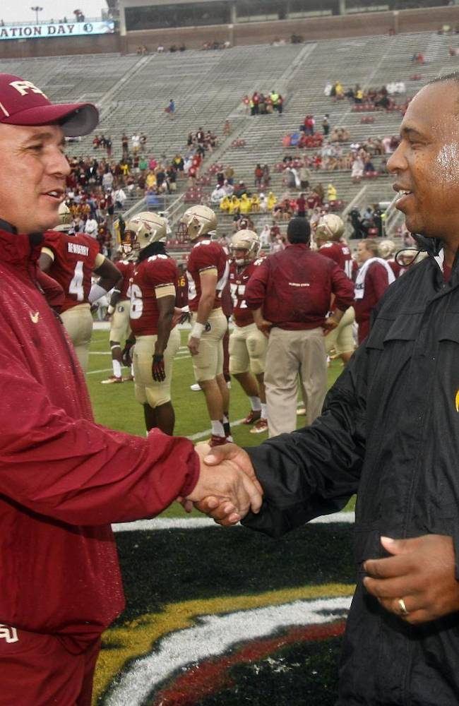 Florida State head coach Jimbo Fisher, left, greets Bethune-Cookman wide receivers coach D. J. McCarthy before the start of an NCAA college football game on Saturday, Sept. 21, 2013, in Tallahassee, Fla. The coaches worked together in the past at Louisiana State University