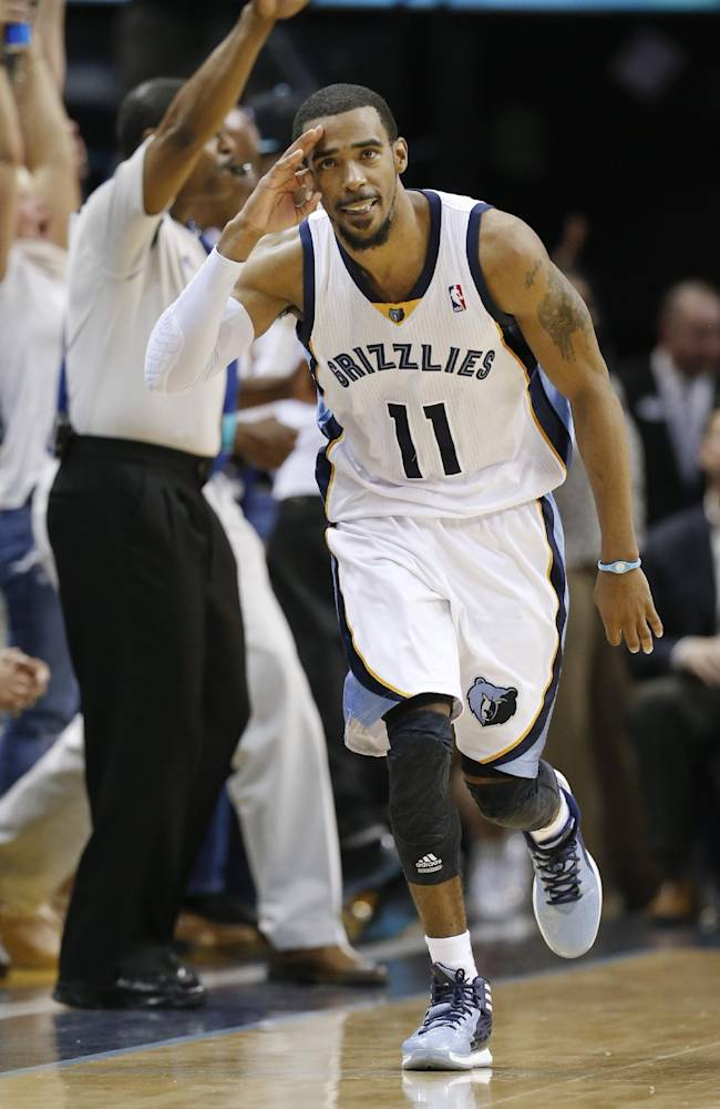 In this April 9, 2014 file photo, Memphis Grizzlies guard Mike Conley celebrates after scoring against the Miami Heat in the second half of an NBA basketball game in Memphis, Tenn. Conley has won the NBA's Joe Dumars Trophy for sportsmanship, Thursday, April 24, 2014