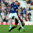 Sunderland's Jordi Gomez, right, vies for the ball with Everton's James McCarthy, left, during their English Premier League soccer match at the Stadium of Light, Sunderland, England, Sunday, Nov. 9, 2014