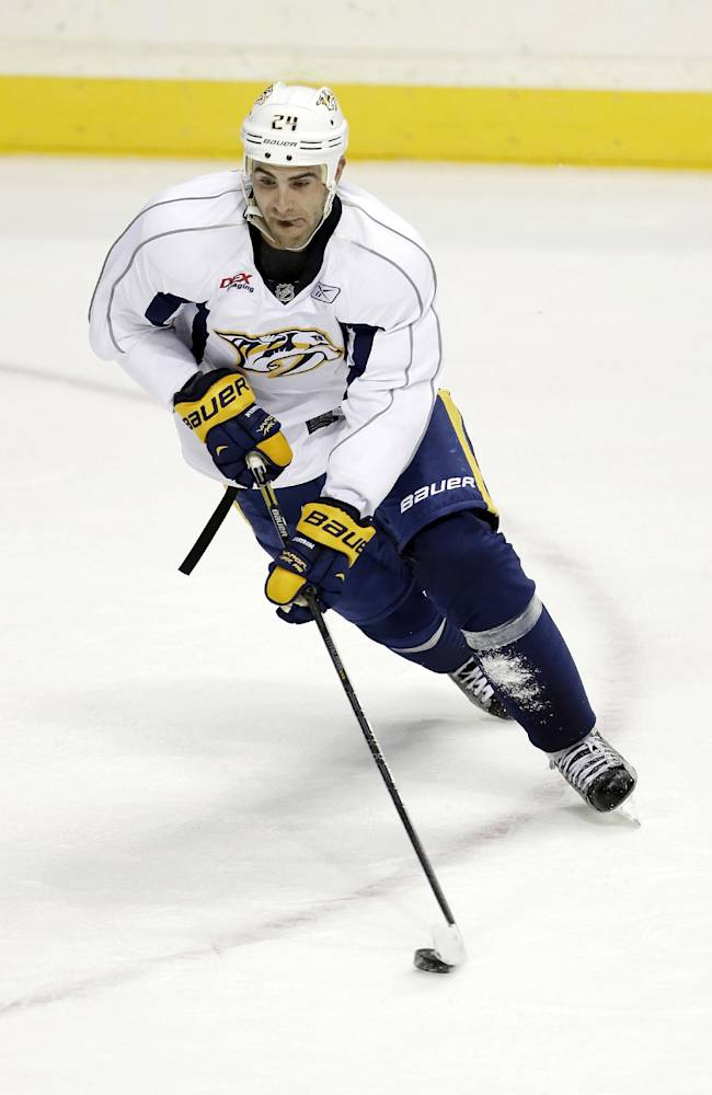 In this Sept. 12, 2013, file photo, Nashville Predators forward Eric Nystrom skates during NHL hockey training camp in Nashville, Tenn.  After failing to make the playoffs last season, the Predators went shopping to try to keep that from happening again. Nystrom is one of the key players signed