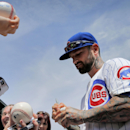 Chicago Cubs' Ryan Roberts signs autographs prior to a spring training baseball game against the Seattle Mariners, Thursday, March 20, 2014, in Mesa, Ariz The Associated Press