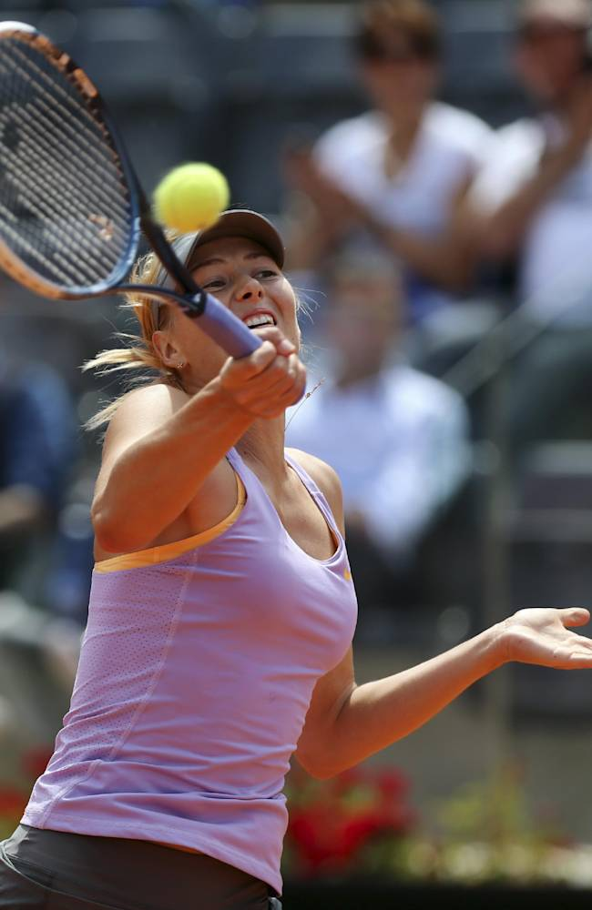 Russia's Maria Sharapova returns the ball to Serbia's Ana Ivanovic during their match at the Italian open tennis tournament in Rome, Thursday, May 15, 2014