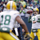 Green Bay Packers' Aaron Rodgers (12) looks to pass to Randall Cobb (18) during the first half of the NFL football NFC Championship game against the Seattle Seahawks Sunday, Jan. 18, 2015, in Seattle The Associated Press