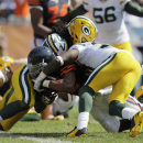 Chicago Bears running back Matt Forte (22) is tackled by Green Bay Packers linebacker Jamari Lattimore, left, cornerback Sam Shields, and safety Ha Ha Clinton-Dix, right, in the first half of an NFL football game Sunday, Sept. 28, 2014, in Chicago. The As