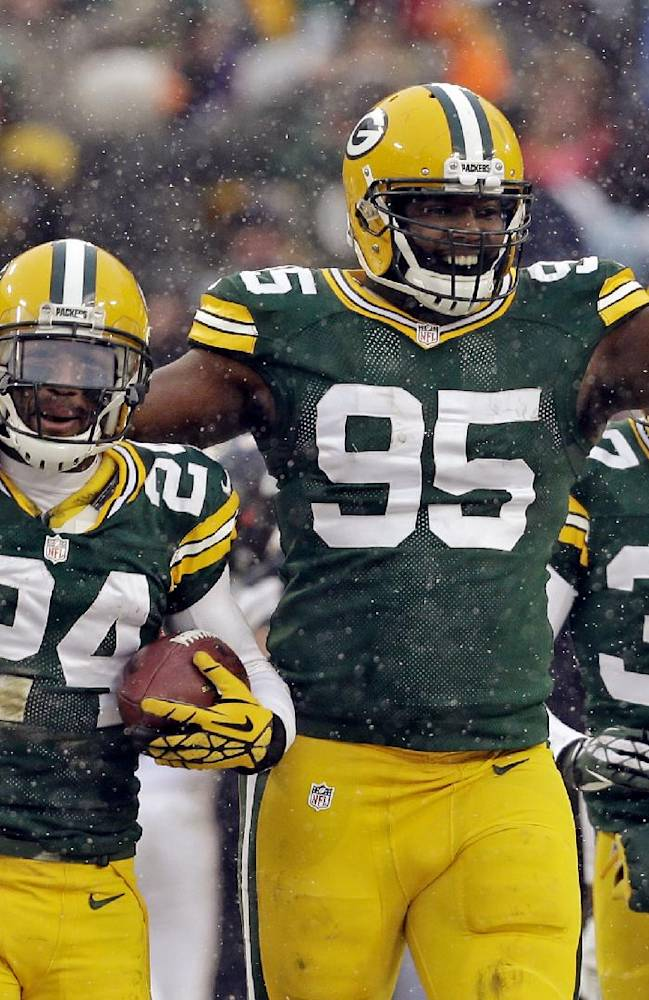 Green Bay Packers' Jarrett Bush (24) celebrates with Datone Jones (95) after Bush intercepted a pass during the final seconds of an NFL football game against the Atlanta Falcons Sunday, Dec. 8, 2013, in Green Bay, Wis. The Packers won 22-21