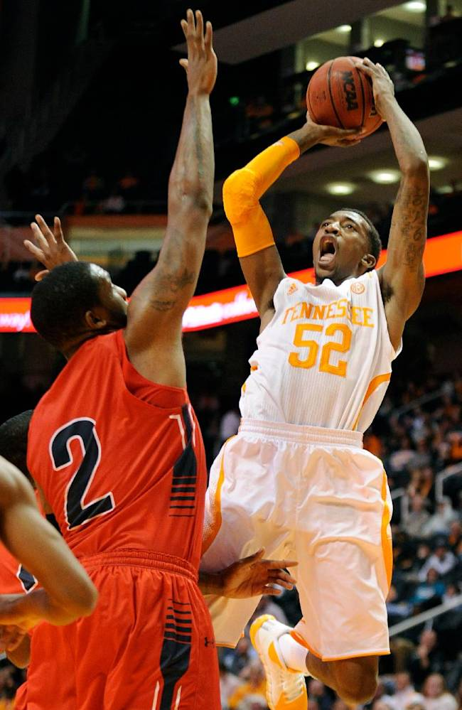 Tennessee guard Jordan McRae (52) shoots over Southern Indiana forward Aaron Nelson (2) during the first half of an NCAA college basketball game in Knoxville, Tenn., Thursday, Nov. 7, 2013