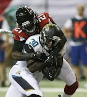 Jacksonville Jaguars running back Jordan Todman (30) prepares to score a touchdown as Atlanta Falcons cornerback Desmond Trufant (21) defends during the first half of a preseason NFL football game, Thursday, Aug. 29, 2013, in Atlanta. (AP Photo/Dave Martin)