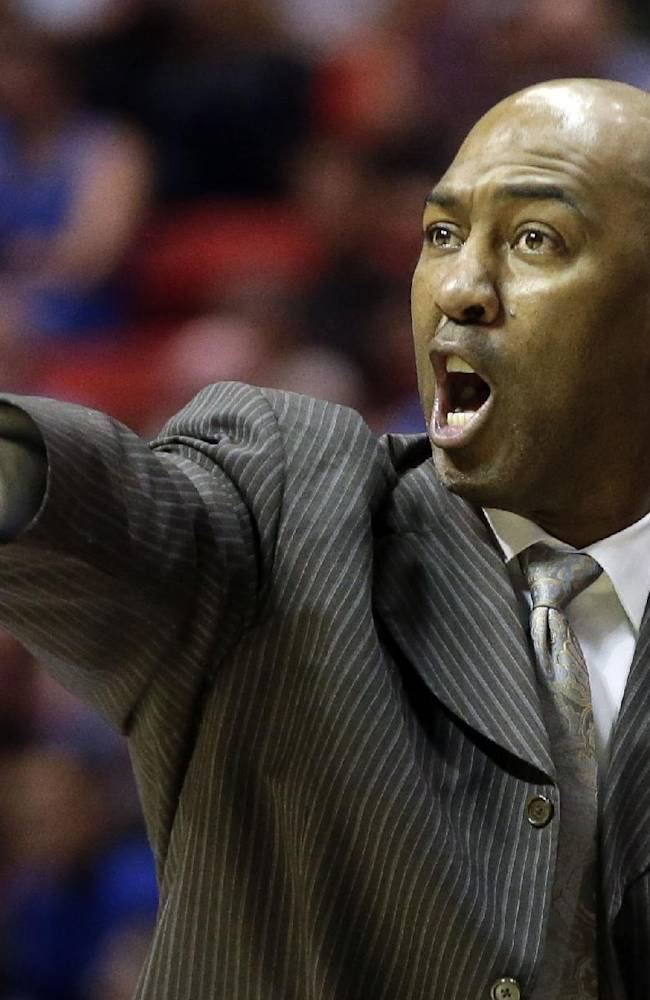 In this March 21, 2014 file photo, Tulsa head coach Danny Manning gestures as his team plays UCLA during the second half of a second-round game in the NCAA college basketball tournament in San Diego. A person familiar with the situation says Wake Forest has hired Manning as its next men's basketball coach. The person spoke to The Associated Press on Friday, April 4, 2014, on condition of anonymity because the school had not announced the hiring