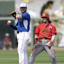 Los Angeles Angels' Collin Cowgill reacts after being forced out at second base during the second inning of a spring exhibition baseball game Thursday, March 20, 2014, in Surprise, Ariz. Kansas City Royals shortstop Jason Donald is at left The Associated