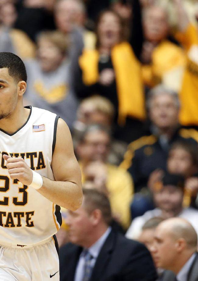 Wichita State's Fred VanVleet points to his teammate after he made a three-point goal against Northern Iowa during the first half of an NCAA college basketball game in Wichita, Kan., on Sunday, Jan. 5, 2014