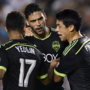 Seattle Sounders midfielder Lamar Neagle, center, celebrates with Seattle Sounders defender DeAndre Yedlin, left, and Seattle Sounders midfielder Gonzalo Pineda, right, after he scores a goal during the second half against the Los Angeles Galaxy during an