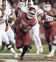 Washington State wide receiver Rickey Galvin, center, attempts to avoid Oregon State safety Ryan Murphy, right, after catching a Connor Halliday pass during the first quarter of an NCAA college football game Saturday, Oct. 12, 2013, at Martin Stadium in Pullman, Wash. (AP Photo/Dean Hare)