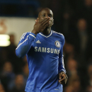 Chelsea's Demba Ba celebrates his goal against Tottenham Hotspur during their English Premier League soccer match at Stamford Bridge, London, Saturday March 8, 2014