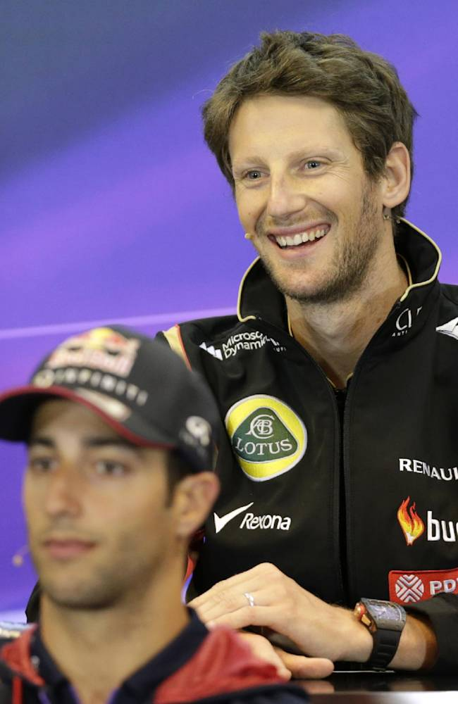 Lotus driver Romain Grosjean of France, top, smiles as he addresses the media with Red Bull driver Daniel Ricciardo of Australia, ahead of Sunday's Belgian Formula One Grand Prix in Spa-Francorchamps, Belgium, Thursday, Aug. 21, 2014