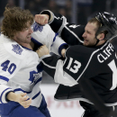 Los Angeles Kings left wing Kyle Clifford, right, and Toronto Maple Leafs right wing Troy Bodie brawl during the first period of an NHL hockey game in Los Angeles, Monday, Jan. 12, 2015 The Associated Press