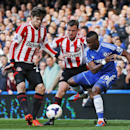 Chelsea's Samuel Eto'o, right, fights for the ball with Sunderland players during an English Premier League soccer match at the Stamford Bridge ground in London, Saturday, April 19, 2014. Sunderland won the match 2-1