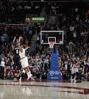 CLEVELAND, OH - DECEMBER 17: Damian Lillard #0 of the Portland Trail Blazers hits the game winning three pointer against the Cleveland Cavaliers at The Quicken Loans Arena on December 17, 2013 in Cleveland, Ohio. (Photo by Gregory Shamus/NBAE via Getty Images)