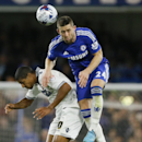 Chelsea's Gary Cahill, right, jumps for the ball with Bolton's Jermaine Beckford during the English League Cup soccer match between Chelsea and Bolton Wanderers at Stamford Bridge Stadium in London, Wednesday, Sept. 24, 2014.