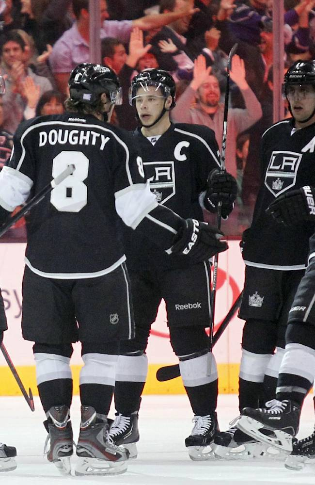 Los Angeles Kings celebrate a goal by Kings center Jeff Carter (77) during the first period of their NHL hockey game against the Ottawa Senators, Wednesday, Oct. 9, 2013, in Los Angeles