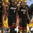 INDIANAPOLIS, IN - MAY 24:  Dwyane Wade #3 and Mario Chalmers #15 of the Miami Heat celebrate after Wade hit a shot and was fouled against the Indiana Pacers in Game Six of the Eastern Conference Semifinals in the 2012 NBA Playoffs at Bankers Life Fieldhouse on May 24, 2012 in Indianapolis, Indiana. The Heat defeated the Pacers 105-93 to win the series. (Photo by Jonathan Daniel/Getty Images)