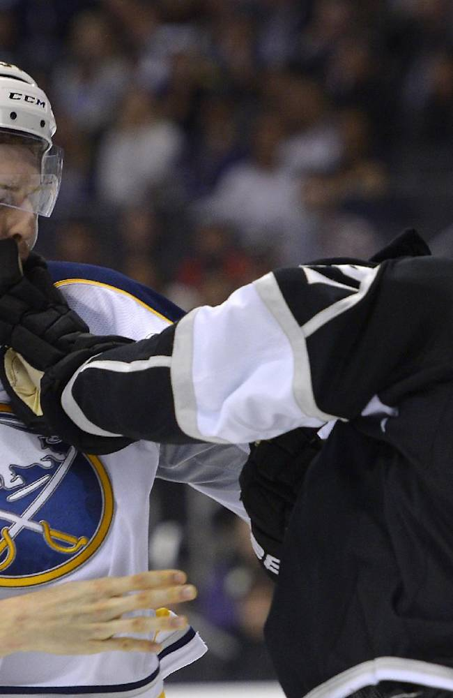 Buffalo Sabres defenseman Tyler Myers, left, fights with Los Angeles Kings right wing Matt Frattin during the second period of an NHL hockey game, Thursday, Nov. 7, 2013, in Los Angeles