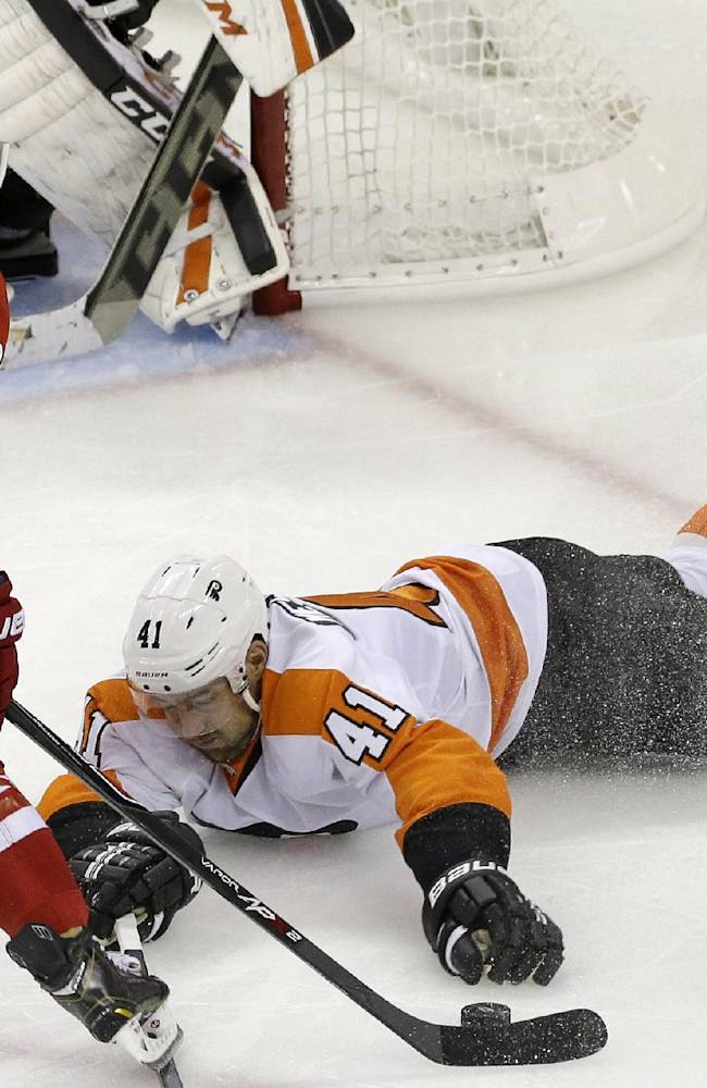 Philadelphia Flyers' Andrej Meszaros (41), of Slovakia, dives as Carolina Hurricanes' Patrick Dwyer (39) controls the puck during the third period of an NHL hockey game in Raleigh, N.C., Sunday, Oct. 6, 2013. Carolina won 2-1