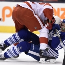 Toronto Maple Leafs' James van Riemsdyk, bottom, and Detroit Red Wings' Riley Sheahan battle during second-period NHL hockey game action in Toronto, Friday, Oct. 17, 2014 The Associated Press