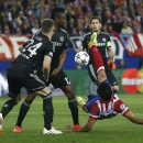 Atletico's Diego Costa, right, is closed down by Chelsea's Gary Cahill, left, and John Obi Mikel during the Champions League semifinal first leg soccer match between Atletico Madrid and Chelsea at the Vicente Calderon stadium in Madrid, Spain, Tuesday, Ap